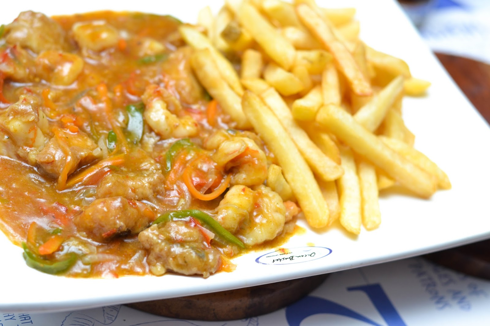 Chips with  Fish & Prawns in Oyster sauce.