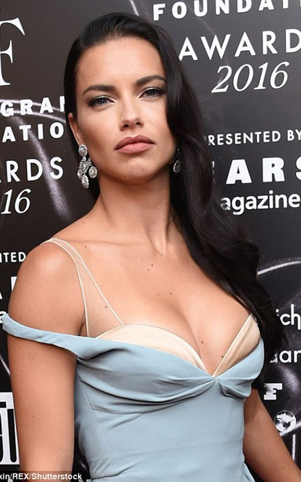 MODEL ADRIANA LIMA : Adriana's designer number revealed her ample bosom as the dress straps fell from her shoulders revealing a bra detail that only focused more attention on her cleavage