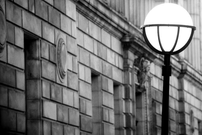 Portland, Maine USA Photo by Corey Templeton from September 2008 outside Cumberland County Courthouse. Black and white photo of street light and old building.