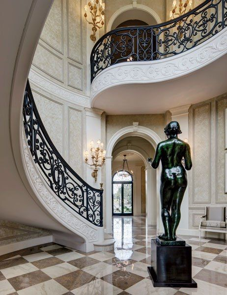 Wrought iron staircase and sculpture in Crispi Hicks Dallas estate