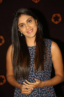 Dhanya Balakrishna Stills in Floral Short Dress at Savitri Audio Launch ~ Celebs Next