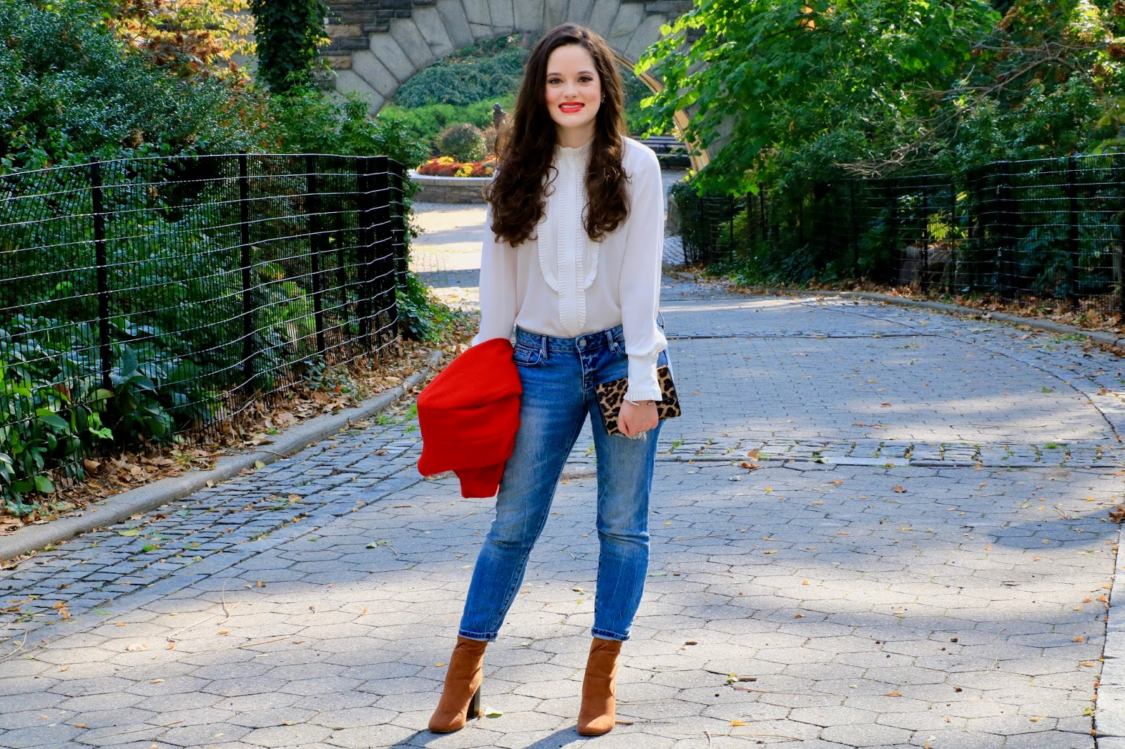 white blouse tucked into jeans