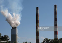 Emissions spew out of a large stack at the coalfired Morgantown Generating Station June 29 2015 (Credit: gettyimages.dk) Click to Enlarge.