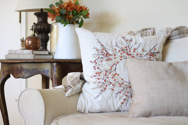 fall home tour orange flowers autumn wreath pillow neutrals