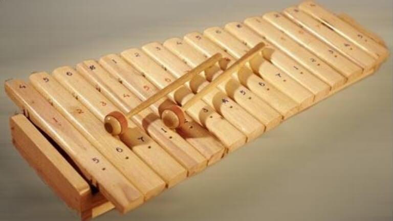 alat musik doli doli dari sumatera utara dimainkan dengan cara dipukul