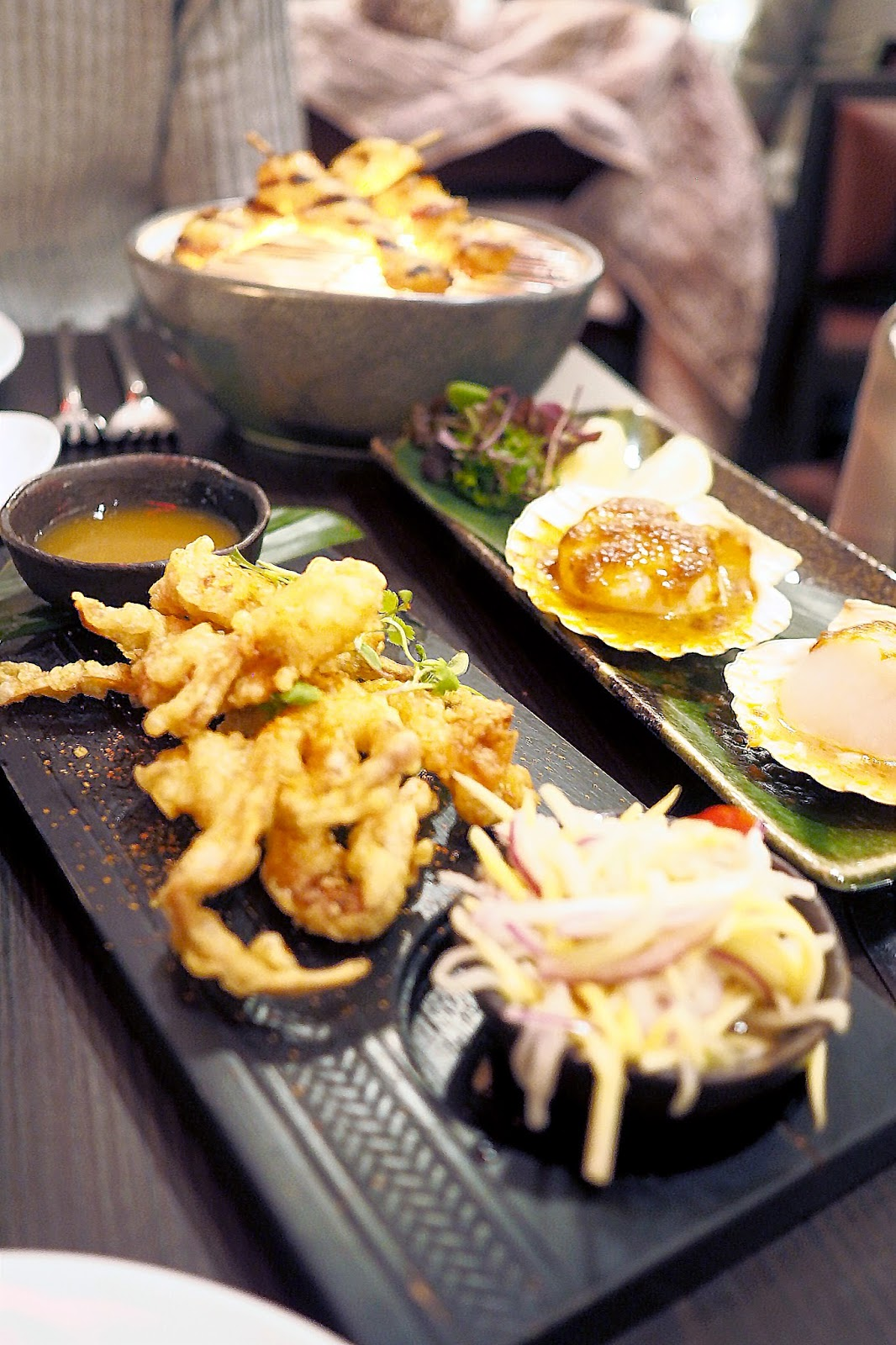Sharing platter of asian dishes