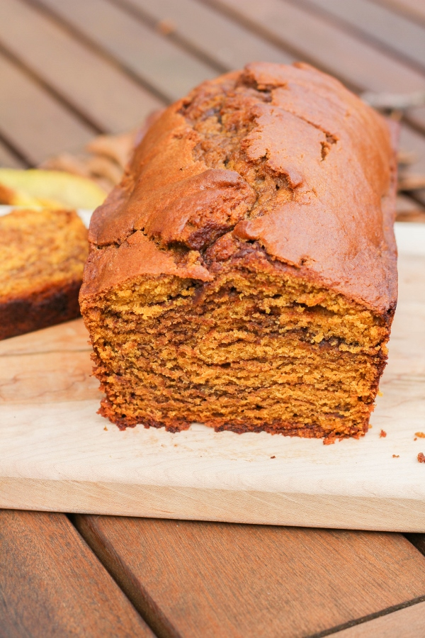 This easy recipe for One Bowl Chocolate Swirl Pumpkin Bread is filled with warm Fall spices and pumpkin flavor, plus a surprise swirl of milk chocolate!