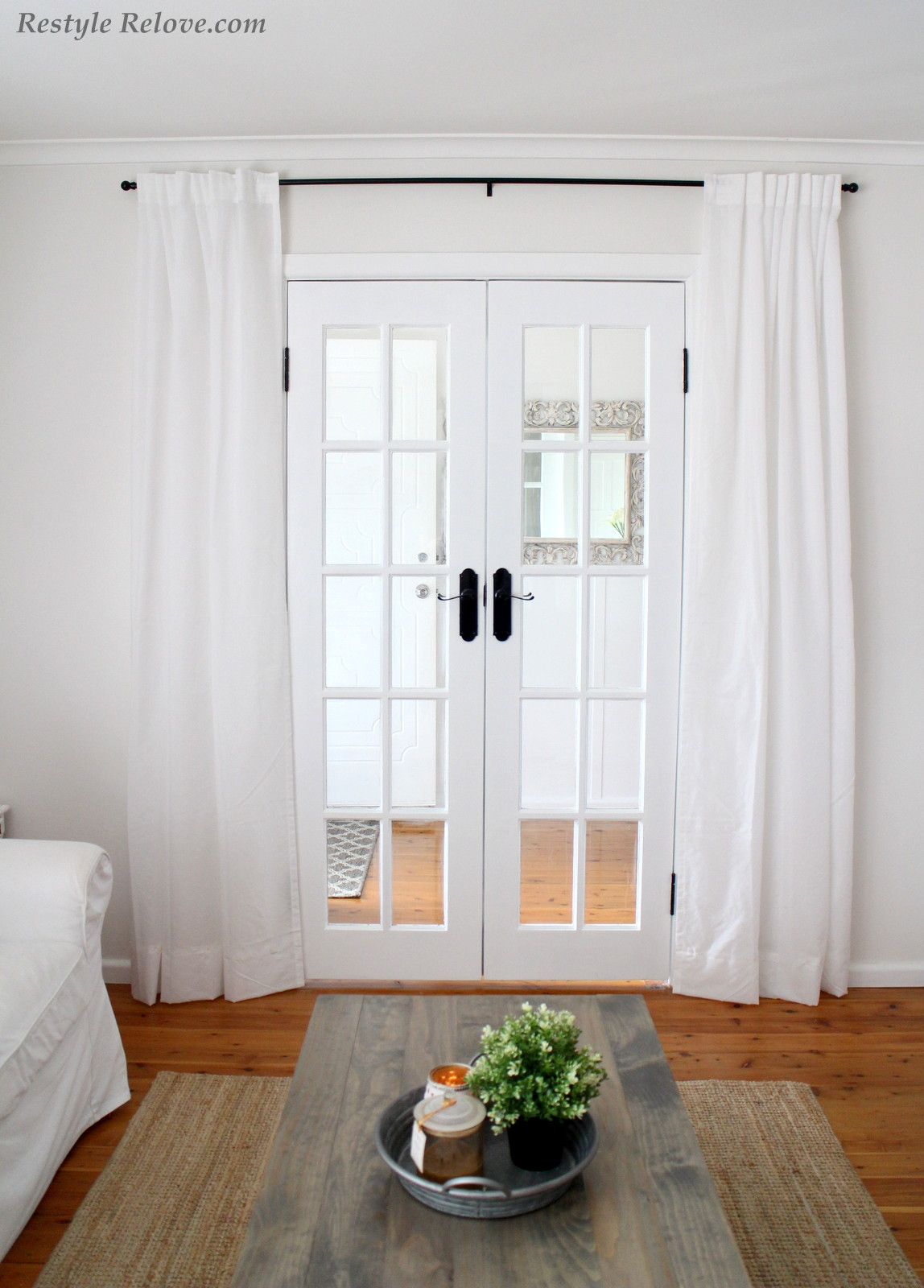 White French Doors Framed By Gorgeous White Ikea Curtains