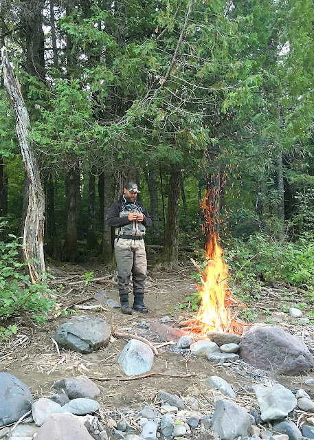 J.P. Tessier by the fire. Bonaventure River