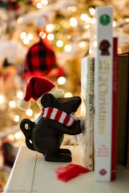 Holiday mouse bookend with hat and scarf to hold Christmas books by the tree