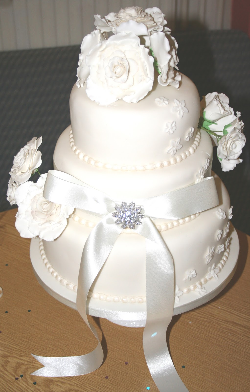 ivory wedding cake with purple roses chintzy cakes ivory wedding cake 16552