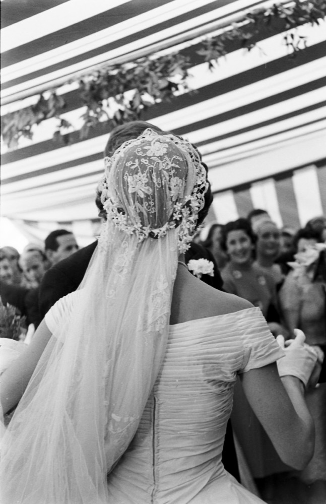 26 candid photographs from the wedding of john f kennedy and view from behind of jacqueline kennedy 1929 1994 in a battenburg wedding dress as she dances with her husband future us president john f kennedy junglespirit Gallery