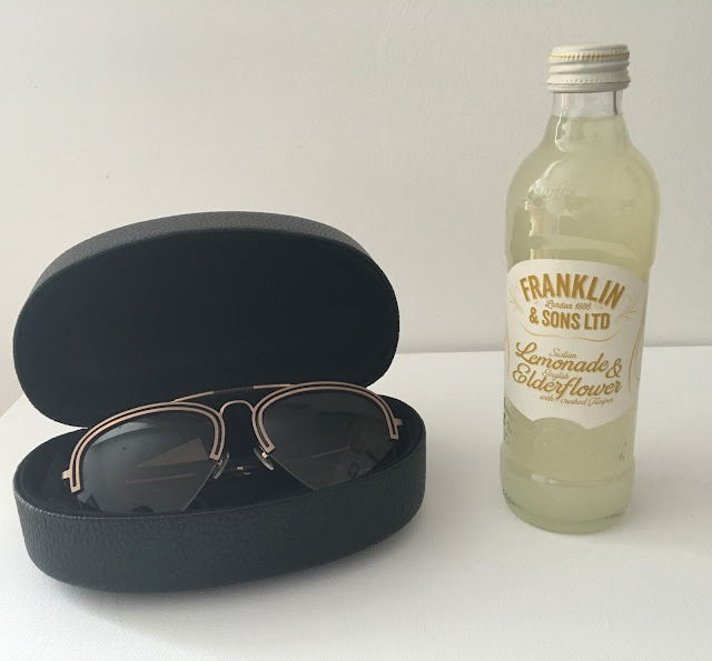 Peridot glasses and Franklin and Sons on white background