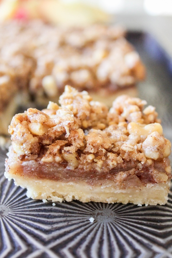 These Apple Walnut Bars are addicting and so easy to make! A sweet apple filling is layered between a shortbread crust and a crunchy topping, making them a hit with everyone!
