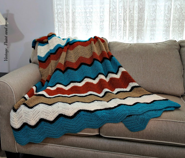 Ripple design afghan done in double crochet in tribal inspired colors