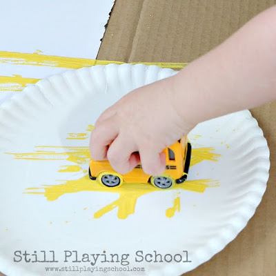 Painting with a toy bus for back to school