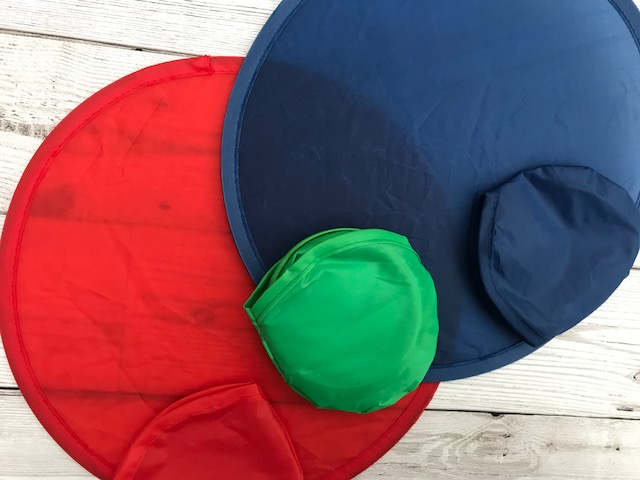 Foldable frisbees and their cases in red, blue and green