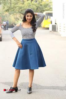 Telugu Actress Roshini Prakash Stills Short Dress at Saptagiri Express Release Press Meet  0230.JPG