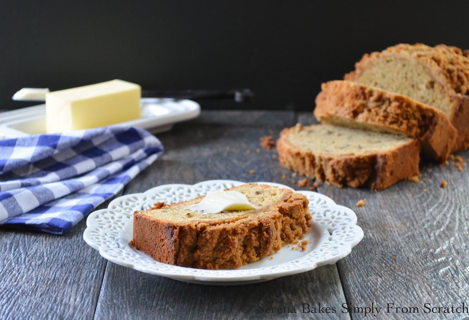 Zucchini Bread with Brown Sugar Crumb and a pat of butter.
