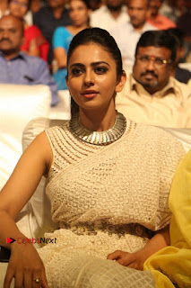 Actress Rakul Preet Singh Stills in White Dress at Winner Pre Release Function  0031.jpg
