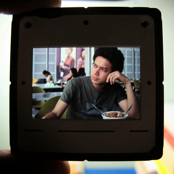 Canonet QL17 GIII rangefinder, Fuji Sensia 100 slide film.