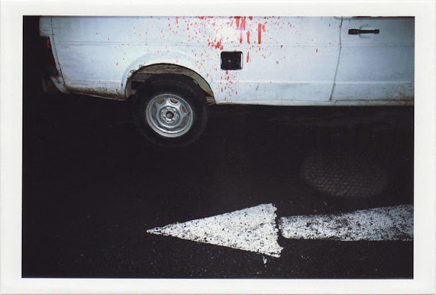 dirty photos - umbra - a night street photo of a car with blood