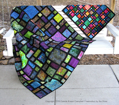 Scattered quilt pattern in batiks and also a mini quilt