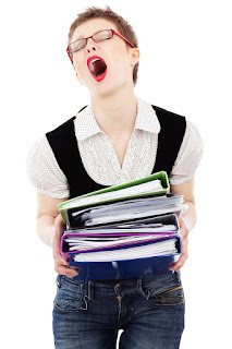 Lady in jeans and shirt ecstatically holding folders of paperwork