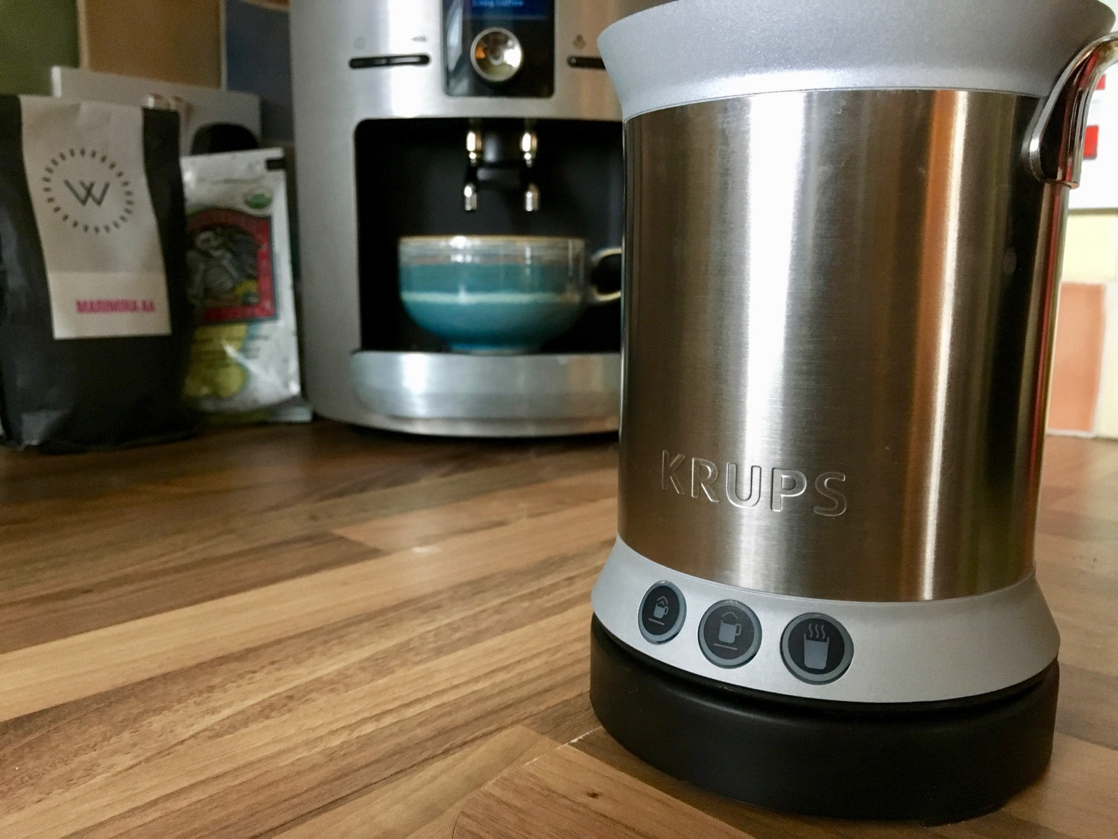 Close-up of the Krups Milk Frother with coffee machine in background