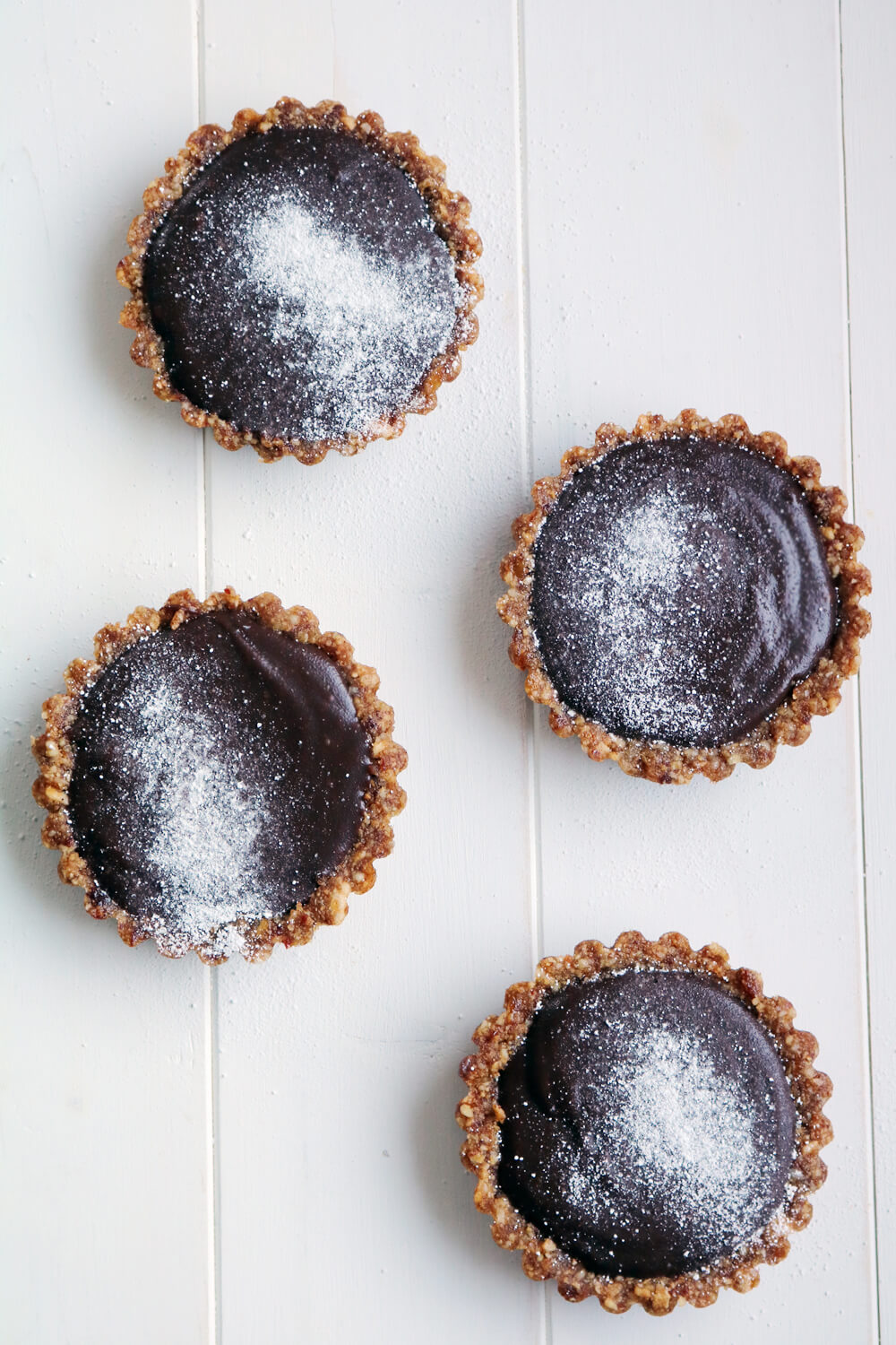 Mini Chocolate Tarts with Raw Date and Nut Crust | Hungry Little Bear