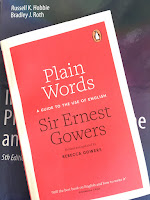 Plain Words, by Sir Ernest Gowers, superimposed on Intermediate Physics for Medicine and Biology.