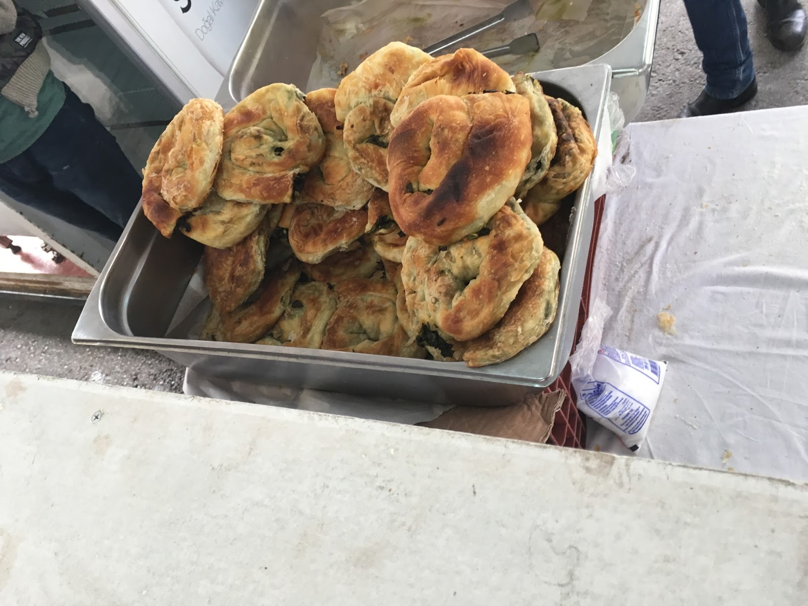 LeeZe visits Izmir Sunday farmer's market. . Home made pastry mostly stuffed with greens, though some have potato inside.