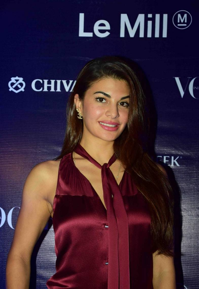 Jacqueline Fernandez Stills In Maroon Dress At Le Mill Collection Launch