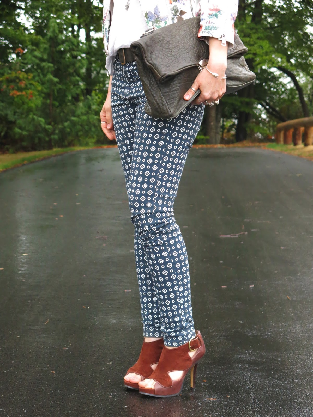 printed skinny pants, cognac heels, and a slate satchel