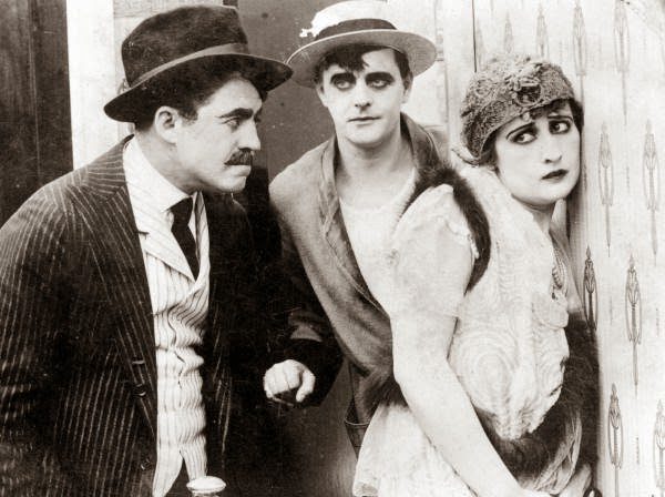 Motion picture scene, 1916.  L-R: Walter Stull(?), Harry Meyers, and Rosemary Thebe.