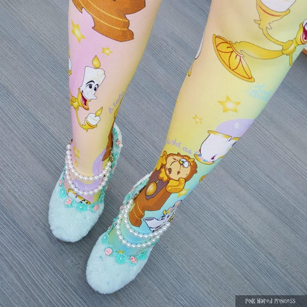 legs standing wearing pastel shoes and disney print tights