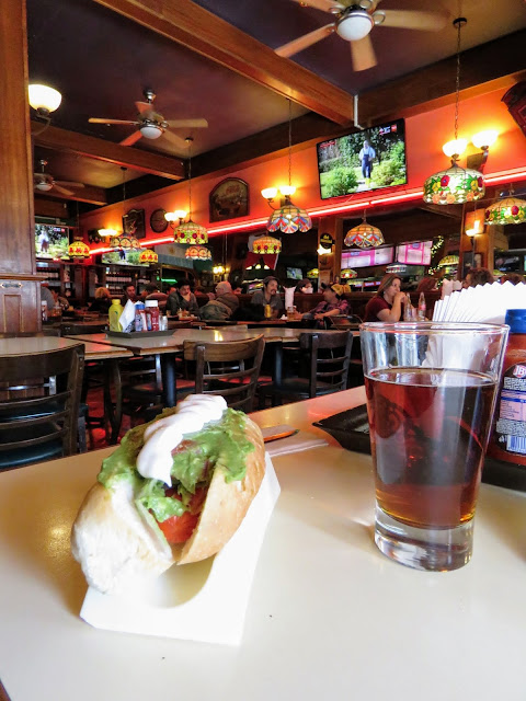 Places to eat in Punta Arenas: a completo (hot dog) and a beer