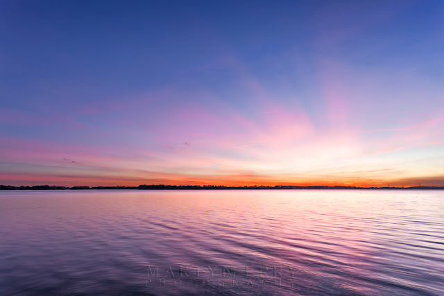 Calm waters at Grafham Water reservoir at sunset in Cambridgeshire