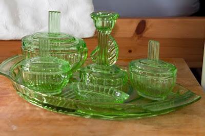 A green glass dressing table set