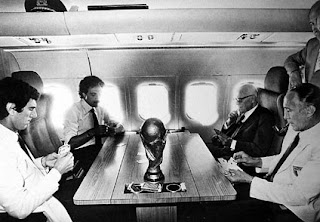 Bearzot, right, playing cards on the plane home from Spain with Dino Zoff, Franco Causio and the Italian president Sandro Pertini