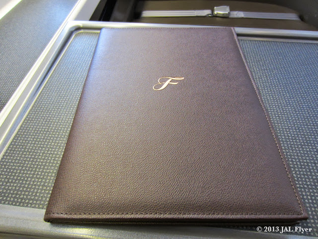 JAL uses a leather portfolio binder to hold menus, immigration forms and a thank you note.