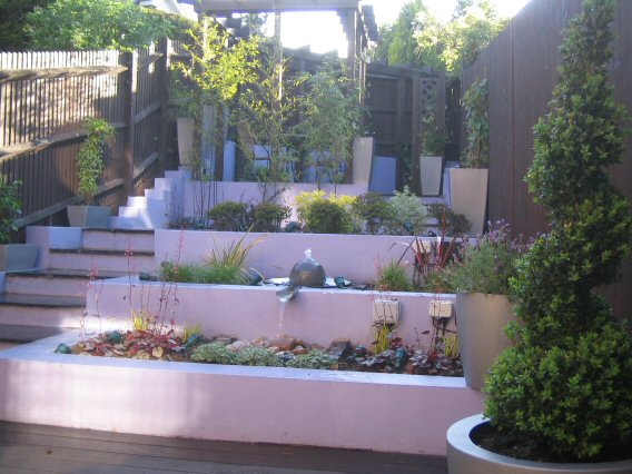 How To Design A Garden potted plants on front porch The Level Changes In A Steeply Sloping Garden Make It Easy To Divide Into Different Rooms And It Is Possible To Create An Interesting Journey Around The