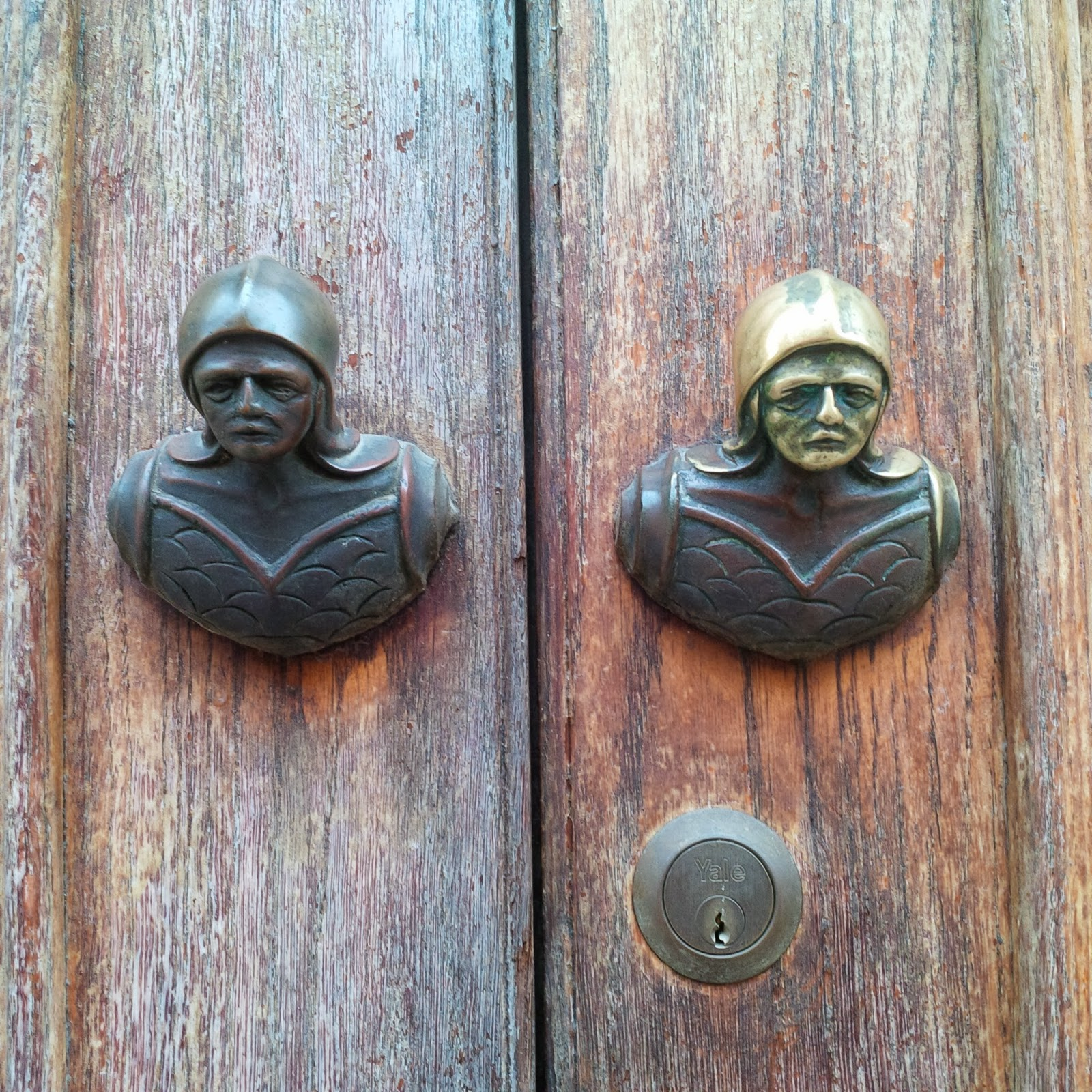 Fabulous door knockers on a building in Vicenza