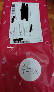 ada logo ALTHEA yang ditempel di paket