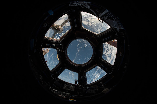 Photo looking at Earth from space.