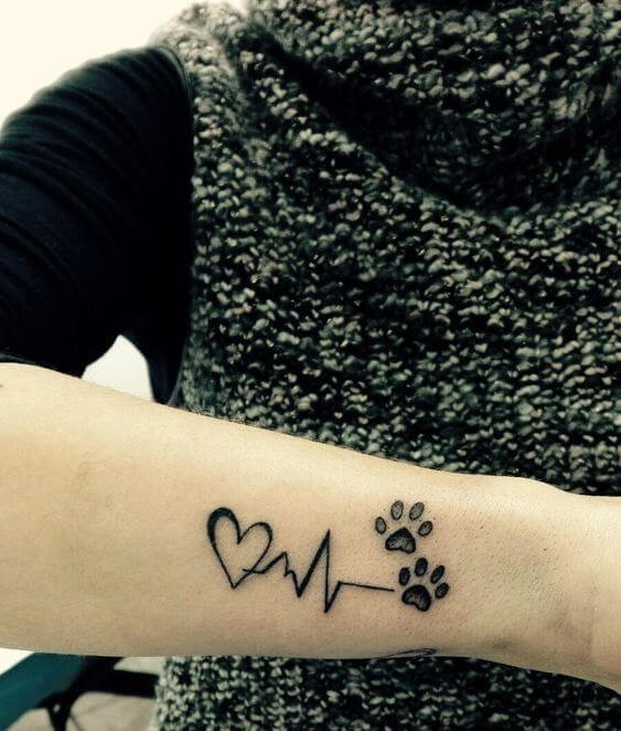 50 amazing paw print tattoo ideas for pet lovers 2018 tattoosboygirl rh tattoosboygirl com puppy paw tattoo pics puppy paw tattoos on leg