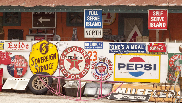 Antique road signs between Austin and Houston in Texas