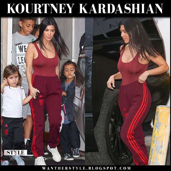 Kourtney Kardashian in burgundy bodysuit and burgundy sweatpants adidas yeezy street style january 15