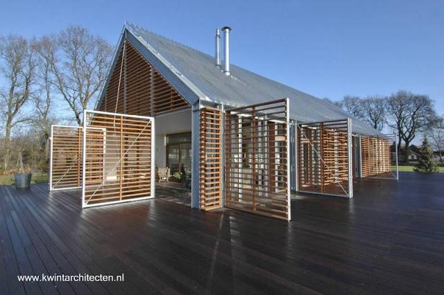 Casa diseñada como un granero, estilo Contemporáneo en Holanda