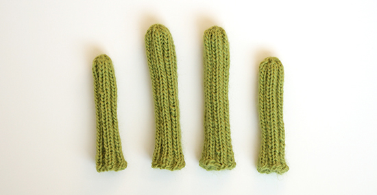 A Set of Four Green Wool Hand Knit Chair Socks